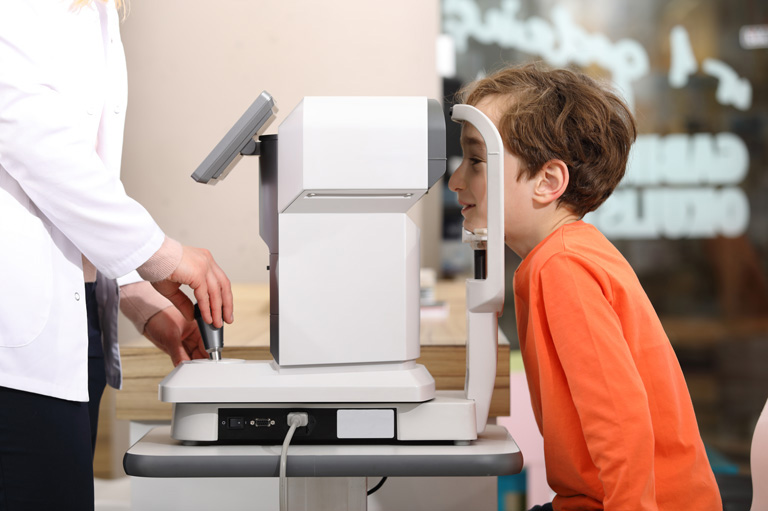 child receiving eye exam