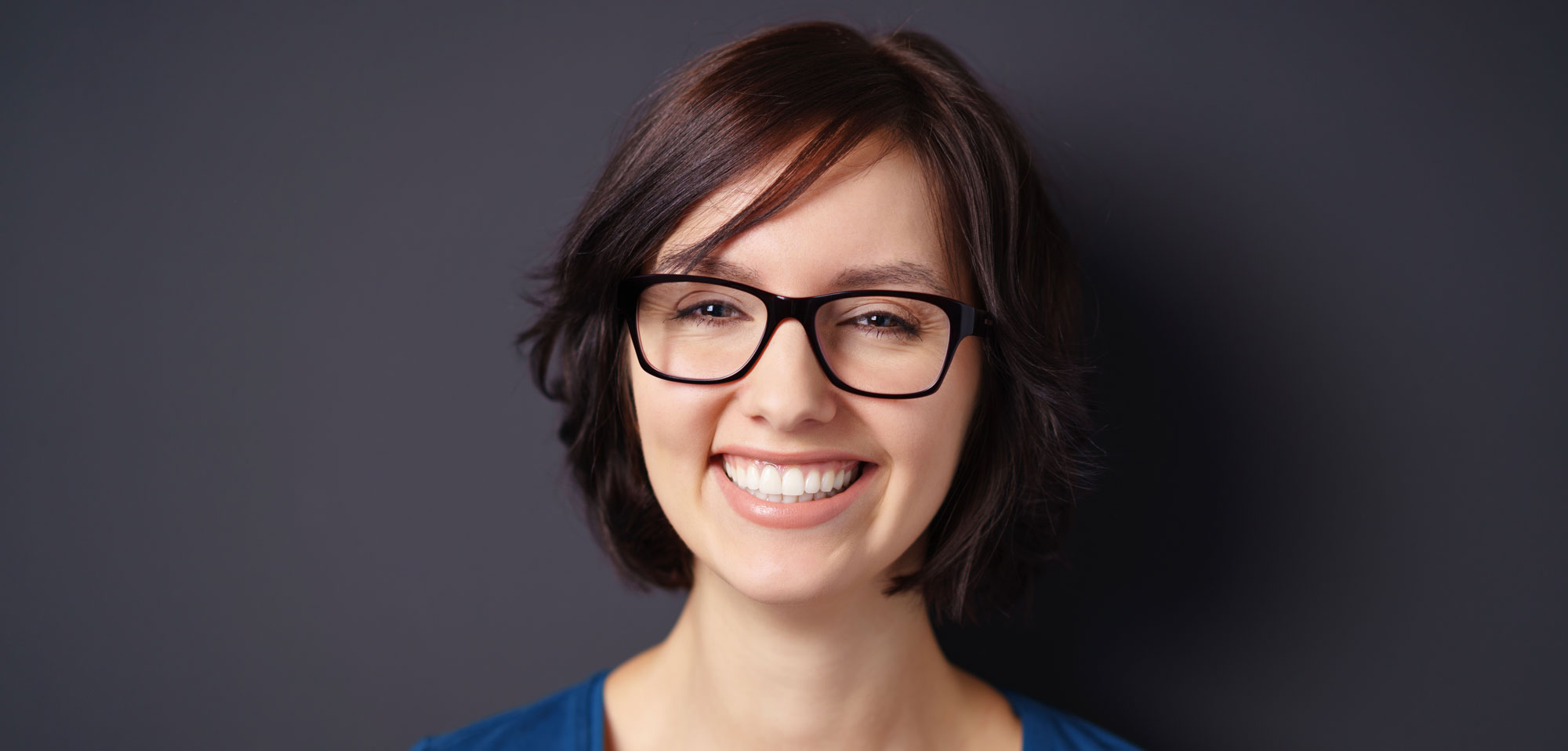 woman smiling with glasses