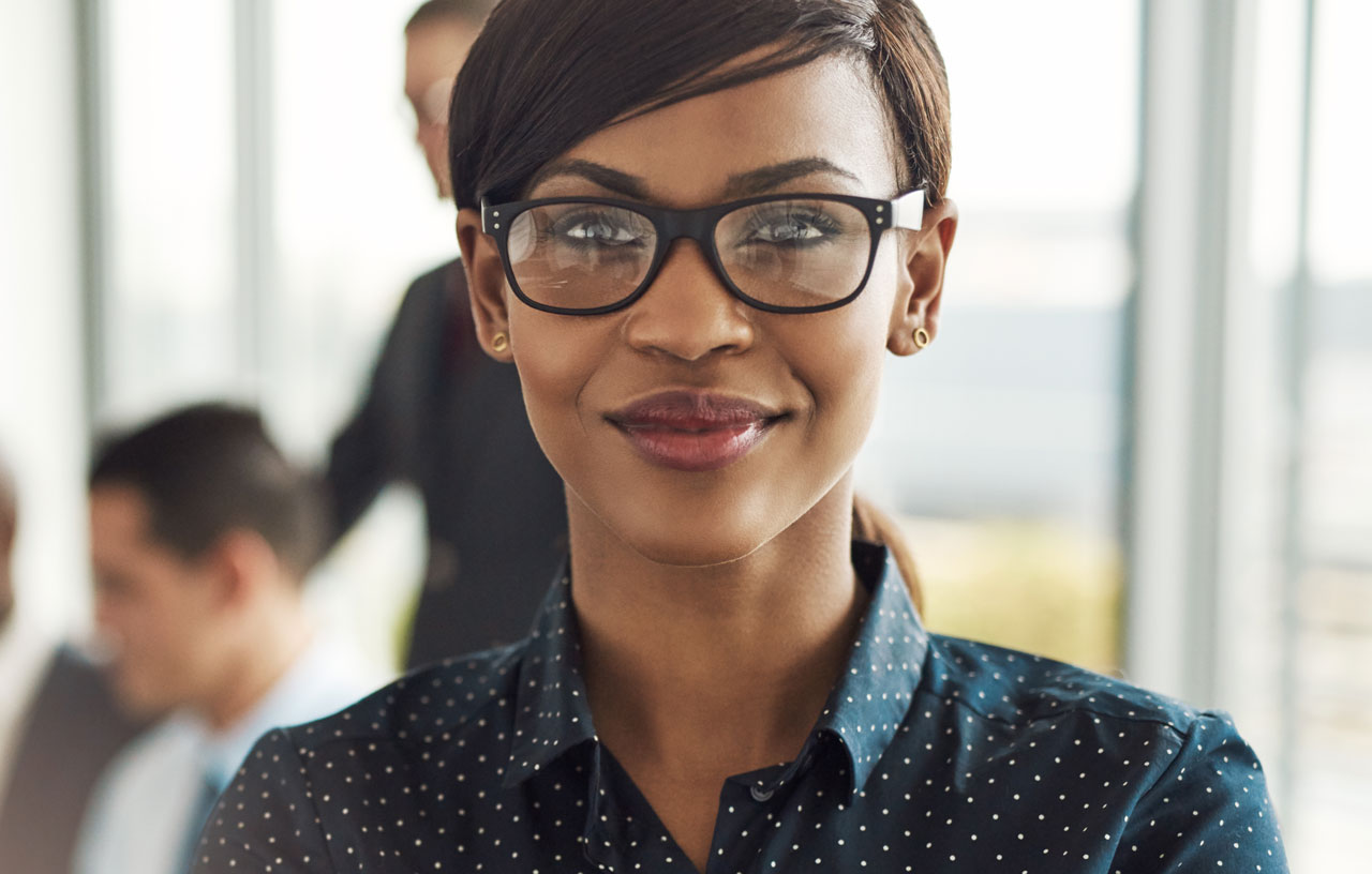 confident business woman wearing trendy glasses